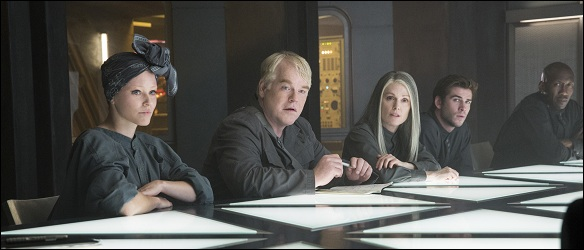 Effie-Plutarch-coin-Gale-cop